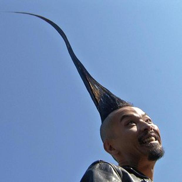 Kazuhiro Watanabe shows off his record-breaking hairdo (AP/Ted Shaffrey)