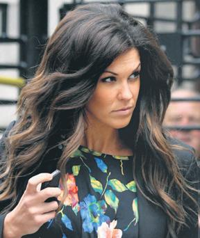 Glenda Gilson leaving court in June after winding up the company which she owned with her brother. She was revealed to be in trouble with the taxman yesterday. COURTPIX