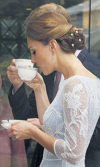 Kate and William attend a diamond jubilee party in Kuala Lumpur