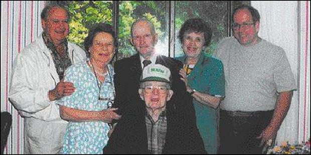 James Hanlon, seated, sporting his Carlingford cap, with his son Kevin, Peggy and Joe Finnegan, his daughter-in-law Gloria and John Topham.
