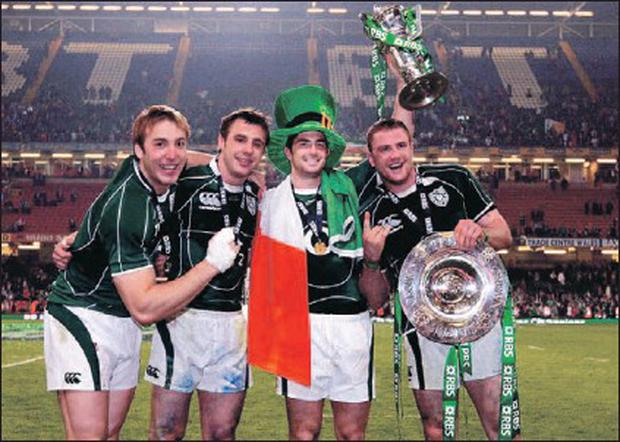 Robert Kearney (2nd right) holds aloft the RBS Six Nations trophy at the Millenium Stadium, Cardiff, as he celebrates Ireland's historic Grand Slam win with Stephen Ferris (left), try scorer Tommy Bowe and Jamie Heaslip.