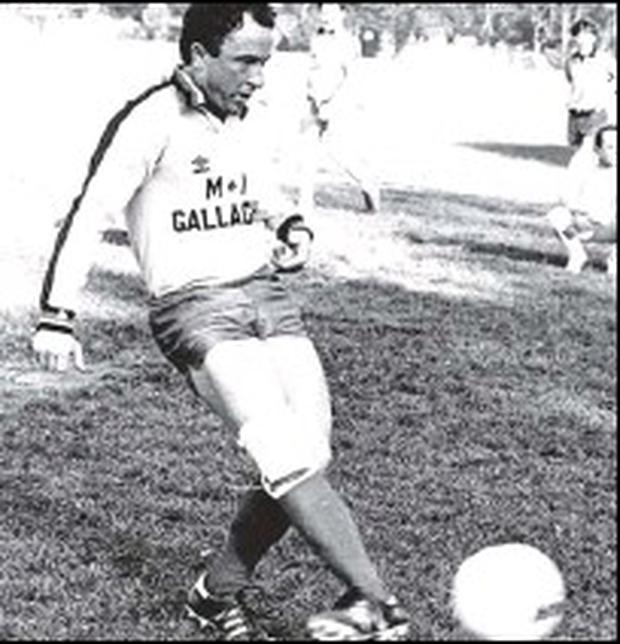 Always a great soccer fan, Dermot Ahern takes a penalty during a Past and Present pupils match at his alma mater, St. Mary's College.