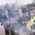 Owen Rooney, Knockbridge (Right) chats with Mickey Brannigan on his half size McLaren Road Loco at the Knockbridge Vintage Show.