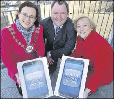 Eanna Ni Lamhna celebrates the new Louth Hidden History App at Millmount Museum with Cathaoirleach of Dundalk Town Council, Marianne Butler, and Brian Walsh, Curator, County Museum.