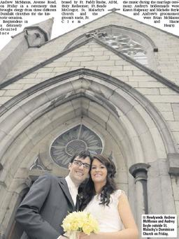 Newlyweds Andrew Mcmanus and Audrey Boyle outside St. Malachy's Dominican Church on Friday.