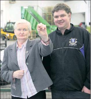 PRAYERS ANSWERED: Joan and recycling centre employee Daryl Tighe.
