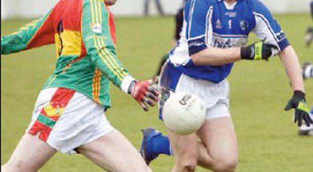 Noel Garvan (right) in action for Laois