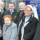 Very Rev Sean Canon Cotter, P.P .Charleville making a presentation to veteran community activist Kathleen O'Sullivan at the St. Patrick's Day Parade in Charleville. Also in the picture are Cllr Michael Donegan, Michael Moynihan TD; Gerard Cott,...