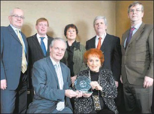 Pictured at the award presentation, front Aidan Forde Irish Examiner with Maureen O'Hara; rear: Frank McCarthy, Pat Lemasney, Carolyn Murphy, Manus O'Callaghan, Donal Deasy.