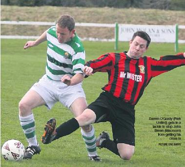 Credit: Darren O'Grady (Park United) gets in a tackle to stop John Breen (Macroom) from getting his cross in PICTURE: ERIC BARRY