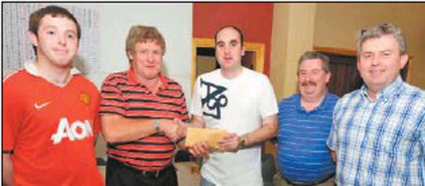 Steven Lynch presents prizes to the winning team captained by Bill O'Keeffe in a table quiz organised in Murphy's Bar Boherbue towards his upcoming trip to Zambia. The triumphant team included Liam O'Keeffe, Bill O'Keeffe, Tom Lovett and Gerard...