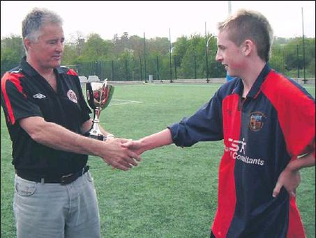 Credit: Bob Grantham presents the U15 League trophy to Lakewood captain Jason Hurley.