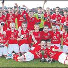 The Mallow United team celebrate their win against, Midleton, after the Cork Schoolboy League Under 12 Cup Final, at Turners Cross, Cork last Monday evening Credit: PICTURE: JIM COUGHLAN