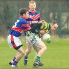 Ballyclough's Barry Mcdermott sees his path blocked by Diarmuid Ryan, Erins Own Credit: PICTURE: ERIC BARRY