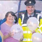 Margaret O'Callaghan, Maureen O'Leary and Margo Connolly of Charleville Suicide Aware group pictured with Garda Nick Phelan at the balloon release in Charleville Town Park to mark Suicide Awareness Day last Monday.