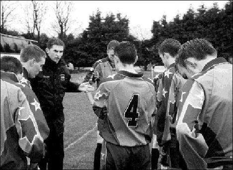 LEFT ... Ian Gardiner, coach of the U-17 St Oliver's soccer team, gives his players a talking to at half time. Included in the picture are Mark McCormack, Colin Woods, Paddy Murtagh, Ciaran Reilly, Luke Traynor, Sean Gilseran and Kenneth Ijomah