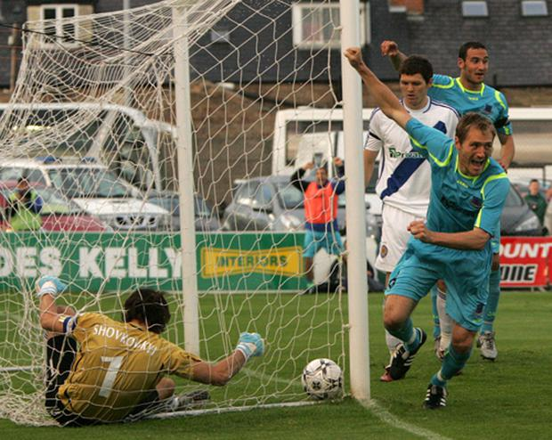 Drogheda United's Adam Hughes leaves Kiev's Oleksandr Shovkovskyy and the ball in the goal during the Champions League game in Dalymount Park. Photo: Paul Connor