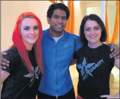 Drogheda Anti-gravity Yoga trainers Vanessa Mcgowan and Laura Armada Buch pictured with ITV Daybreak presenter Gavin Ramjaun.