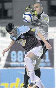 Gavin Brennan challenges Derry keeper Ger Doherty in the air.