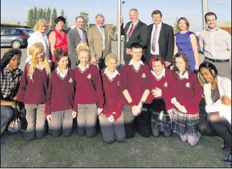 Group pictured at the raising of the Green Flag at St. Oliver's Community College.