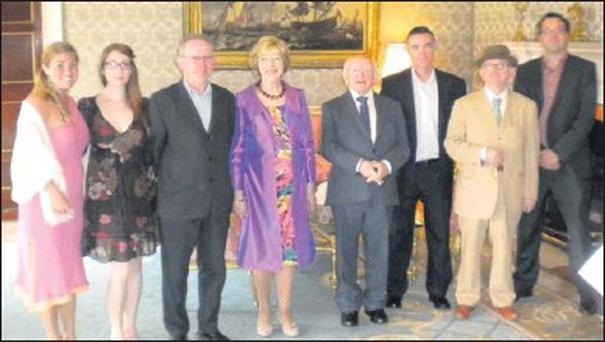Elaine Cronin, Courtney Grile, Hugh Doogan, Declan Mallon, Paddy Goodwin and Alan Costello from the Upstate Theatre Project with President Michael D. Higgins and his wife Sabina at Aras an Uachtarain during the President's annual arts garden party.