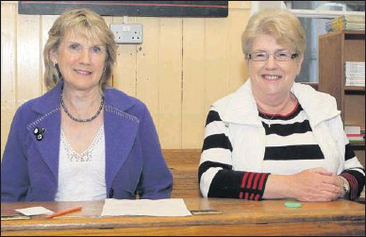 Rita Martin and Bridie Tuite pictured during the recent open evening at Fatima school in the old desks which are now for sale in Fatima and Congress.