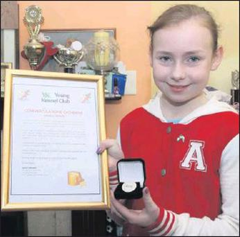 Catherine Broaders from Shannon Hill, Enniscorthy, winner of the Young Kennel Club art competition overall prize at Crufts dog show in England.