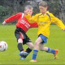 Seán Redmond of Rosslare Strand is challenged by Kilmore's Ryan Carroll during the Mini World Cup quarter-final on Saturday.