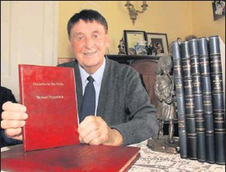 ■ Michael Fitzpatrick with bound copies of his previous works.