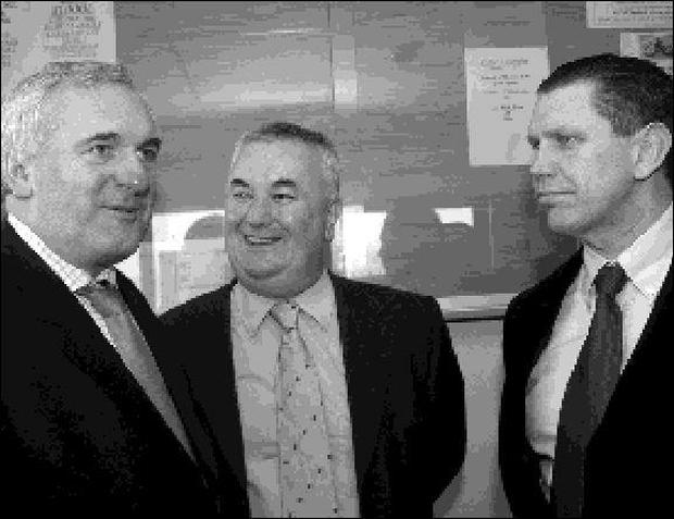 GV Wright TD (centre) and Mick Ryan, vice-chairman, with Taoiseach Bertie Ahern at the opening of Naomh Colmcille's new clubhouse. Pics: Kieran Corrigan/KCP