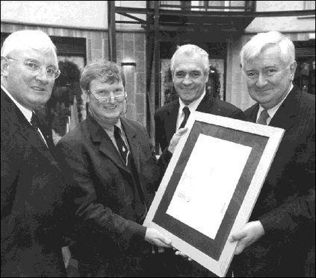 Science and Technology Minister Sean Treacy (left) with the overall winner of the IBM/STI National Science & Technology Journalism Awards 2000, Gerry Byrne (second left). Also pictured are John Travers, Chief Executive Forfas, and William Burgess, Managing Director IBM Ireland.