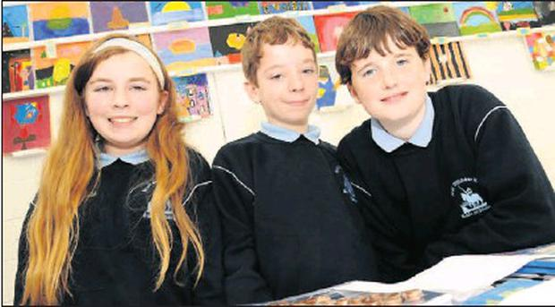 Jade McConnell, Niall Gavin and Gareth Sweeney showcasing their experiment for Science Week at Balrothery NS.