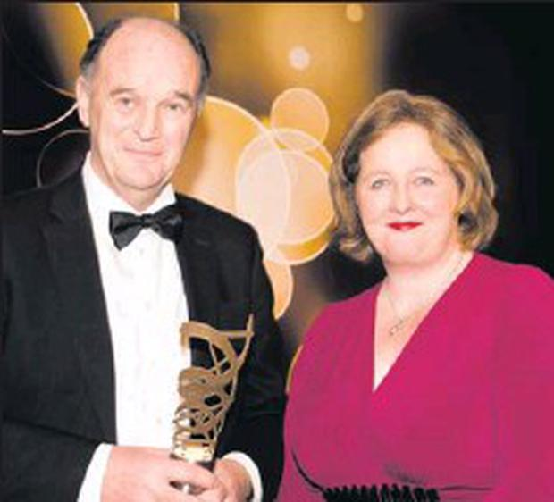 David Hickey, recipient of the Lifetime Achievement Award in November 2011 with Olive Fogarty, Chairman of Award Sponsors Ogilvy One Dublin, at the Irish Health Care Awards in the Shelbourne Hotel, Dublin.