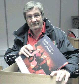 Cllr Frank Snowe packing up his desk at the Balbriggan Fás office.