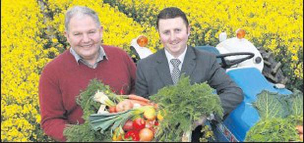 Michael Hoey, Managing Director, Country Crest and Paul Horan Senior Business Manager, Bank of Ireland Business Banking at the Country Crest farm in Lusk