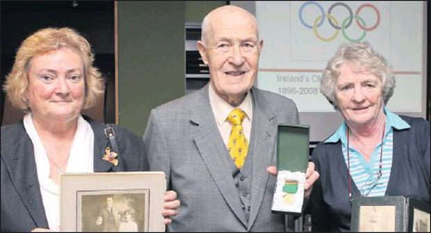 Former Irish Basketball Olympian Harry Boland (pictured here in the centre) has passed away