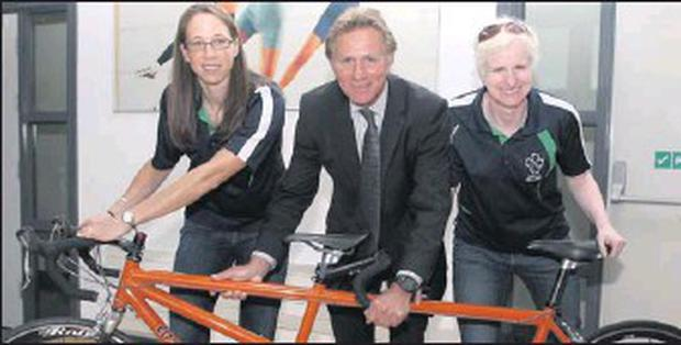Catherine Walsh (right) with tandem cycling partner Fran Meehan and Eamonn Coghlan at a presentation by Irish Blind Sports to vision impaired Paralympians.