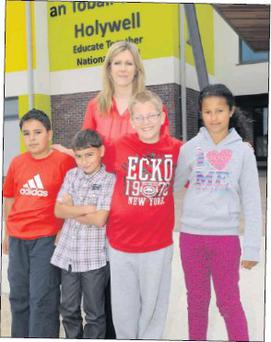 Holywell Educate Together principal Maria Boyne with pupils Denis, Denis, Krzysztof and Antonette