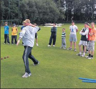 John Mooney gives a demonstration on how to maximise distance when throwing the ball.