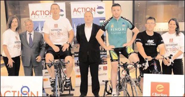 Lisa Halligan, Fran Whelan, Peter O'Shea with Andrew O'Neill, Tony Finnegan, Alan Howley and Neelie Murray at the Action Ireland Charity Cyclethon in the Pavilions Shopping Centre.