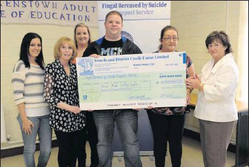 Sarah Copinger, Fiona Dennis, Mark Dolan with Coleete Leetch, Laura Erasmus and Mary Forde at the cheque presentation to the Fingal Bereaved by Suicide Group.