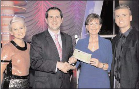 From left: Sinead Kennedy, Gameshow host, Nigel Scully, Head of Sales, The National Lottery, Noreen Thompson, participant who played on behalf on her son, and Brian Ormond, Gameshow host.