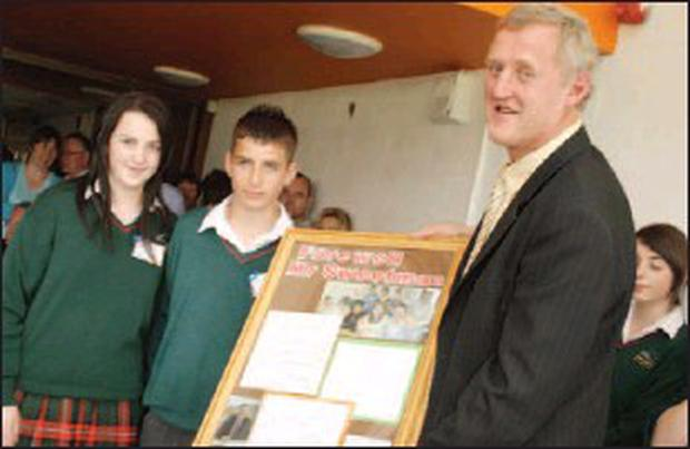 Pupils Rebecca Farrell and Craig Travers making a presentation to School Principal Nicky Sweetman to mark the official opening of the Ward-Rice building at Gorey Community School.