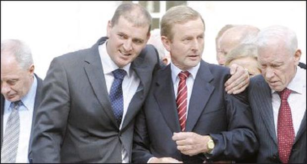 Deputy Paul Kehoe puts his arm around Fine Gael leader Enda Kenny after the Mayo TD survived a leadership challenge from Richard Bruton in 2010
