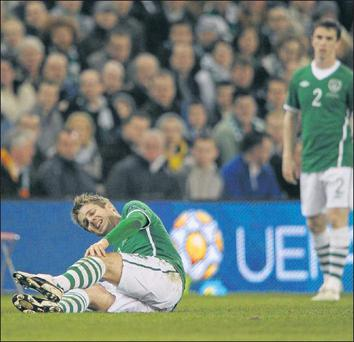 Kevin Doyle goes down with a knee injury during Ireland's Euro 2012 qualifier against Macedonia at the Aviva Stadium on Saturday night.