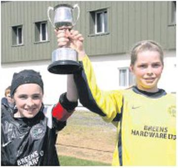 Joint Shelbourne captains Niamh Kehoe and Kate Hendrick lift the Under-12 cup.