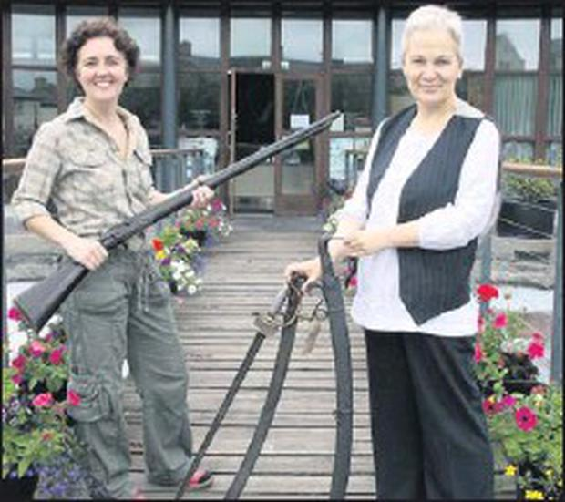 Jacqui Hynes (left), manager of the 1798 centre with a Brown Bess Musket and tourism rep Mary O'Higgins with a cavalry sword and two infantry swords. These are just some of the 1798 items that have now gone on display at the 1798 centre in Enniscorthy.