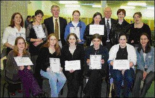 Students of Tralee Community College who received certificates in Child Care at the awards ceremony on Tuesday night. Front from left: Siobhan Guerin, Dingle, Comasa Roche, Newcastlewest, Laura O'Connor, Dingle, Claire O'Sullivan, Lispole, Maria Guerin, Kilcummin, Marian Harmon, The Spa. Back from left: Siobhan Shanahan, Moyvane, Miriam Cronin, Duagh, Michael O'Donnell teacher, Catherine O'Leary, Currow, Philomena O'Shea, Kenmare, Principal Billy Curtin, Geraldine O'Sullivan, Abbeydorney, and Karina Griffin, Castlemaine.
