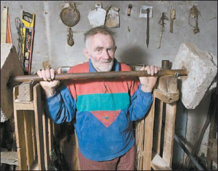 Kerry's Iron Man, Mick Murphy, working out at his home in Cahersiveen with makeshift barbells.