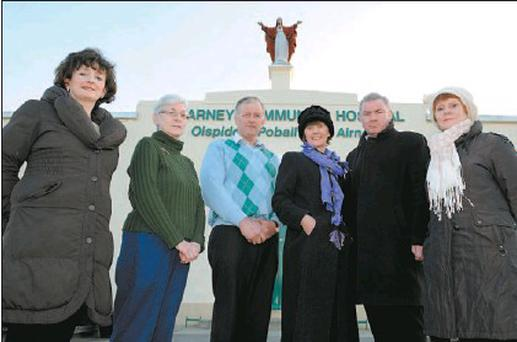 Breda O'Connor, Marian Tangney, Colr. Brendan Cronin, Marfgaret O'Sullivan, Fr Nicholas Flynn and Christina Moynihan at the Sacred Heart statue prior to be removed from above the entrance of the Killarney Community Hospital Killarney on Friday morning.